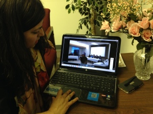 Rizvi shows videos of her volunteer work in Pakistan, where she spent three weeks treating medical patients for free.